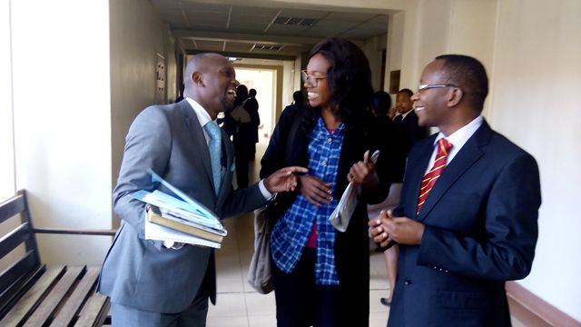 Audrey Mbugua with lawyer Stephen Mwanza Gachie for the human rights activist Solomon Gachira who filed a suit seeking orders to restrain the Attorney General from implementing of two thirds gender rule until the transgender are included leaving Milimani law courts after  court directed the matter to be placed before CJ to appoint a bench.31 July,2015.